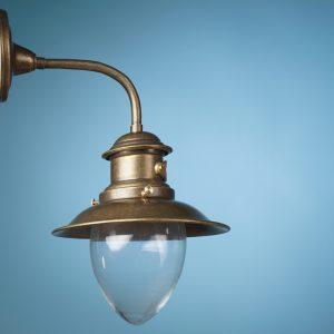 Luč stenska medenina svetleča lok